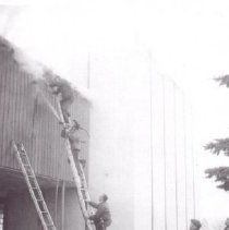 Image of Print, Photographic - Firemen on a ladder fighting a fire