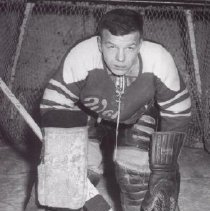Image of Print, Photographic - A hockey goalie at the goal post