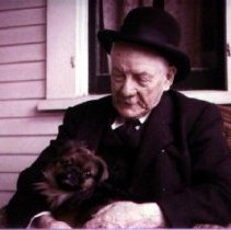 Image of Print, Photographic - Dr. Robert McCaffrey with his Pekingese dog Toy