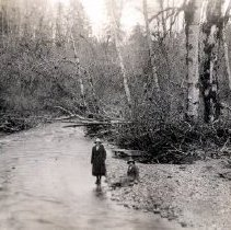 Image of Print, Photographic - Portrait of Hilda Manuel and friend standing near large stream