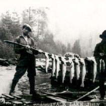 Image of Print, Photographic - Portrait of Billy Voight and E. Atkins posing with stick lined with fish caught at Chilliwack Lake.