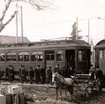 Image of Print, Photographic - View of passengers boarding a B.C. Electric Railway tramcar at the Chilliwack station