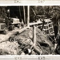 Image of Print, Photographic - Men & equipment of the Clarke Brothers Timber Company working on construction of a high trestle bridge.