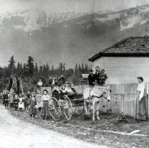 Image of Print, Photographic - View of students & teacher on road beside Rosedale School