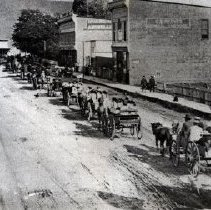 Image of Print, Photographic - Procession of first nations peoples travelling down Wellington Street in wagons.