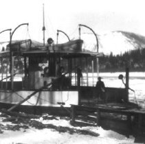 Image of Print, Photographic - Side and end view of local Fraser River ferry Sea Wolf locked in river ice.
