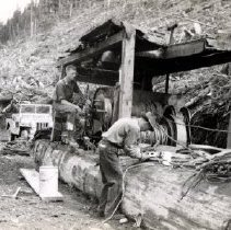 Image of Print, Photographic - View of Bob Pehota (left) and Harry Pehota working with logging equipment.