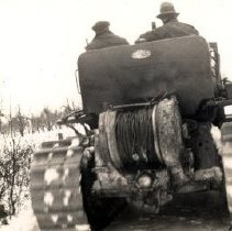 Image of Print, Photographic - End view of caterpillar tractor clearing snow from road.