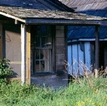 Image of Print, Photographic - Close view of small lean-to porch on back of the former John and Harriett Chapman house.