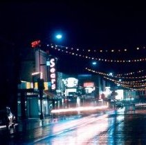 Image of Print, Photographic - View of traffic and commercial district on Wellington Avenue at night.