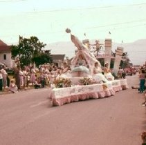 Image of Print, Photographic - Front view of the Pacific National Exhibition float in the Canada Day parade.