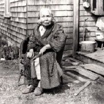 Image of Print, Photographic - Portrait of Agnes Milo seated outside of home