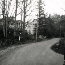 Image of Print, Photographic - View of an unidentified soldier on road, with house in background.