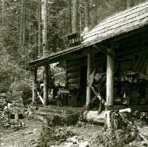 Image of Print, Photographic - Front view of the log home of Charlie Lindeman at Chilliwack Lake.