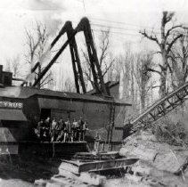 Image of Print, Photographic - Side view of a huge dragline shovel Bucyrus, with crew of men standing on side platform.