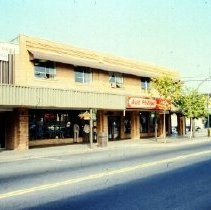 Image of Print, Photographic - Front view of businesses and commercial buildings along Yale Road East.