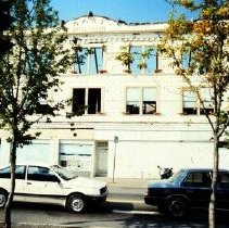 Image of Print, Photographic - Close side view of the burnt out shell of the Hart Building at Five Corners.