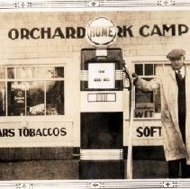 Image of Print, Photographic - Portrait of Kenny Wilkinson with hand on gas pump at his Orchard Park Camp Home Oil gas station.