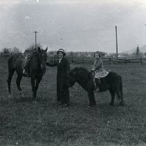 Image of Print, Photographic - Small girl on pony with woman beside horse