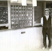 Image of Print, Photographic - Man standing in front of post office boxes