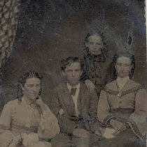 Image of Family of 2 women, 1 man and 1 girl, ca.1875.