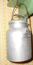Image of 065.006.A.B - Aluminum one quart milk can with handle and separate lid from household of Mrs. Florence Cooper McCann.