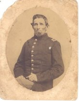 Image of PO.002.0056 - Mounted original of Lloyd Rees in Civil War Uniform.  Lloyd Rees's fife, flute, powder flask, US buckle are in the Museum collection.    Oval, matte print mounted on buff cardboard.  Sepia color print.