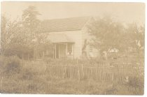 Image of PO.002.0060 - Jacob Rachor home at 3rd and Bendigo in North Bend.  Taken before the street was graded.  Last home of Alice Borst Rees Rachor was in a house on the rear of this lot built by her son Jerry for her.  Grandmother Euphemia Rees lived here with Alice until Euphemia died in 1910.  Oblong, plain house with roofed porch, picket fence.