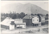 Image of PO.015.0031 - Snoqualmie with Mount Si in background- Stores on Railroad Ave and Kinsey Hotel.