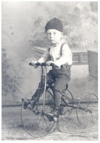 Image of PO.015.0235.2 - Grove Gable, Mary Lou McKibben's mother's half-brother on tricycle.