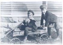 Image of PO.015.0246 - Evan Albert McGilva and Everett Everett Edwards McGilvra (Mary Lou McKibben's uncles) on wagon brothers bought with $5 they found.  c 1905