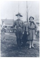 Image of PO.015.0247 - John McKibben in Boy Scout Uniform with sister Mary McKibben (Durfee) taken in 1932 at Fall City in backyard of what was later 33509 SE 43rd Pl in background is Sorensen's house and garage later owned by the Straights.