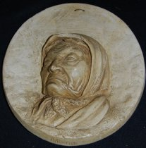"Image of 010.004 - Molded face of Princess Angelina, Chief Seattle's daughter. Made of plaster, painted, round plaque with face in center; CW Chapman, Sr. and name ""Angelina"" imprinted in plaster."