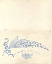 """Image of 145.082 - Marriage Certificate holder  4-3/4"""" x 7-7/8"""".  The holder is a folded cardboard, covered with a white alligator grained paper.  There is a silver Lily of the Valley spray, and doves on the front.  Marriage Certificate is printed in the silver.  It opens in booklet form, the certificate would fit on the inside.  The paper is bent and cracked."""