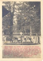 Image of PO.989.0001 - This Merry Go Round is operated by tread power. The lady on the right is in position to operate it as soon as the men holding it (for this picture) will release it. It is in operation in Maloney's Grove. U.S. Patent no 1860194 is for sale by Peter J. Maloney North Bend, Washington.