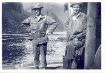 Image of PO.989.0003 - Art Branam, foreman, Gus Erickson, engineer on rig on Cedar Lake. 1926-1927. Pacific States Lumber Co logging at Cedar Lake.