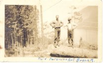 Image of PO.989.0012 - Del ? and Foreman Art Branam. Pacific States Lumber Co logging at Cedar Lake, 1926. Art Branam, foreman. I tailrigged two settings. Rig was steam, on a float, tailholted across the lake! We had a Dunham System skyline.