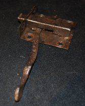 Image of 008.001 - Door Latch from Uncle Si's cabin which burnt down.  Cabin was located on old Mt. Si Ranch.  Si Merritt was first settler in Valley. Mt. Si bears his name.
