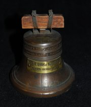 "Image of 003.067 - Liberty Bell Bank, STATE BANK OF NORTH BEND, Childs bank.  Bronze, shape of Liberty Bell with wood hanger.  Inscribed with Scripture Lev XXV 10.  ""Proclaim Liberty throughout all the land unto all inhabitants thereof"" Small brass plate on side of bell gives name of Bank and location. Slot for inserting coins is on bottom. Pat. Feb 18, 1918.  The Bankers S and C System, Cleveland, Ohio #41134.  Other Patents pending.