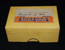 Image of 015.230.A.B - Edgerly Pill box. Pill-box from Edgerly's Drug Store in North Bend. It contained sodium benzoate powder or benzoate of Soda. Box measures 2 by 3 inches. It is 1.25 inches deep. There are traces of the material yet in the box. The box is a yellowish tan. The Label has Edgerly's in blue on orange background.