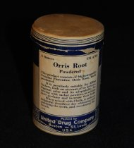 "Image of 015.253.A.B. - Medicine aid, pure test orris root, powdered. a cardboard container of powdered orris root. contained 4 ounces. Packed by the United Drug Company. Has a Blue label with a description of what it is used for on the back. 3.75"" tall with a 2.5"" diameter."
