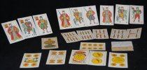 """Image of 075.356 - Monte playing cards. 48 cards. 2.5"""" x 3.875"""". The cards have a red print on the back. The front of the cards have the number, pictures of the articles that are on the face of the cards. These cards were used by the Spanish for the gambling game of Monte."""