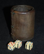 "Image of 001.031.A.B.C.D - Leather Dice box and three dice used in Mr. Taylor's store.  Initials ""K.B."" likely for pioneer Kenos Branam carved in script on side."