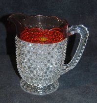 Image of 002.035 - Glass pitcher quart size, hobnail with cranberry red top from household of Mrs. Lloyd (Euphemia) Rees.