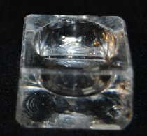 Image of 002.050 - Individual glass salt dish.  Square shape with round center used in household of Mrs. Lloyd Rees.