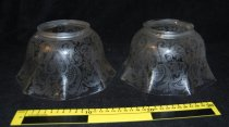 "Image of 102.027 - Two clear glass light shades that fits a glass fixture. 4"" diameter x 5"" high and flares to 8.5"" across, in an eight sided fluted pattern. The entire shade is etched with a scroll and floral design.