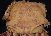 Image of 015.1008 - Tan and red leather pillow. 1906. Cowboy.