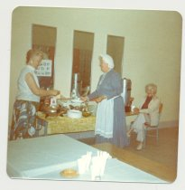 Image of PO.015.0291.h - Antique Show and Sale to benefit Museum held in North Bend Grade School Gym presented by Dick Mattila and his wife. Museum table to sell cookies, punch and coffee. Chairman for luncheon served to Antique dealers at Sale was Esther Johnson at Lunch- Peggy Corliss.