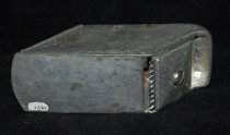"""Image of 050.055 - Ice shaver used in Drug Stores. Galvanized iron two pcs., hinged lip, cutting blade screwed to end 4 """" long 2 1/8"""" high 2 1/4"""" wide Stamped on lid """"Gilchrist No 78"""""""