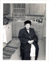 Image of PO.986.0053 - J Muriel Brown in her kitchen.